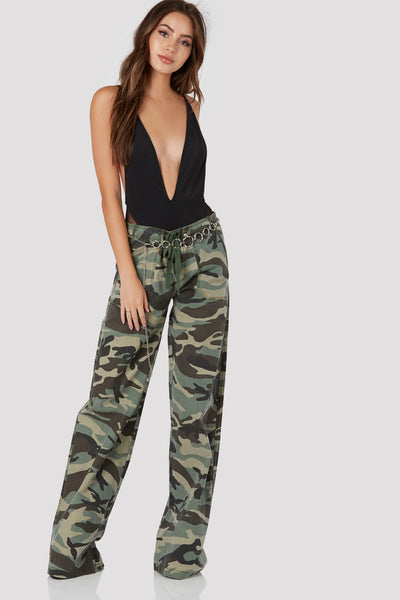 Trendy oversized printed pants with wide leg fit. Drawstring at waist with button zip closure.