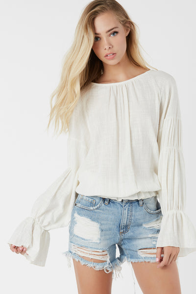 Lightweight dolman sleeve top with rounded neckline. Flirty ruffle hem finish with oversied fit.