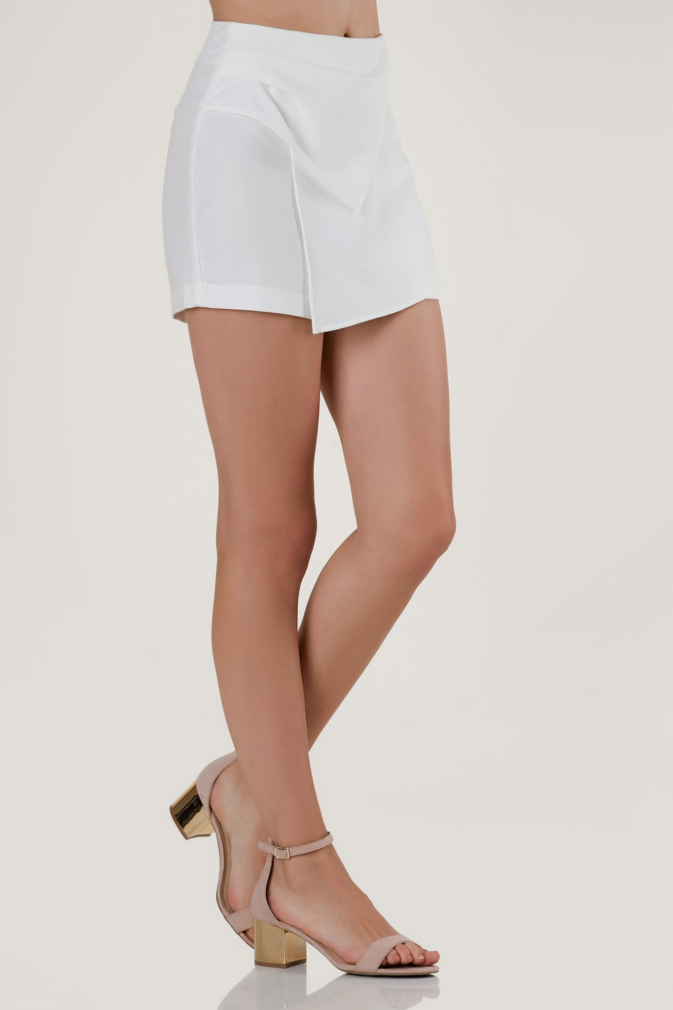 Chic high rise envelope shorts with asymmetrical hem finish and hidden back zip closure.