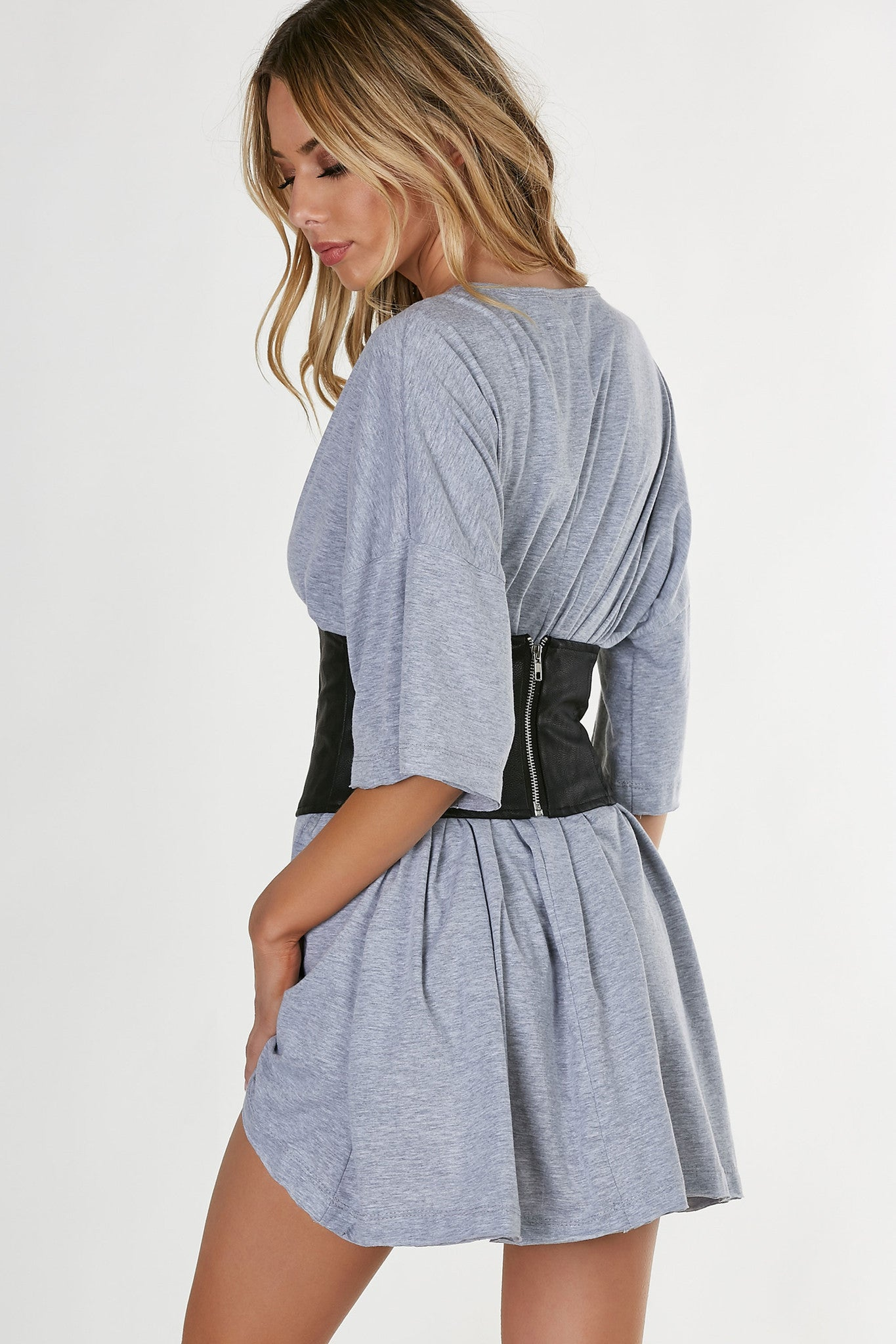Sexy faux leather waist belt with trendy lace up design in front and back zip closure.