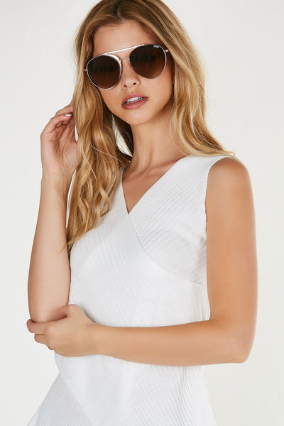 Chic aviator style sunglasses with rounded metal frame and mirrored lenses.