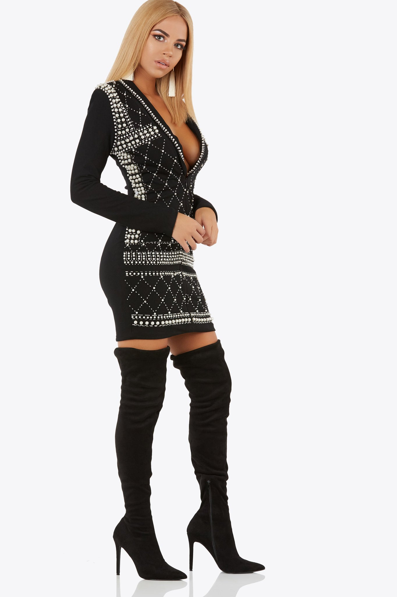 Feel like a queen in this beaded and embellished dress. Features long sleeves and deep v-neckline.