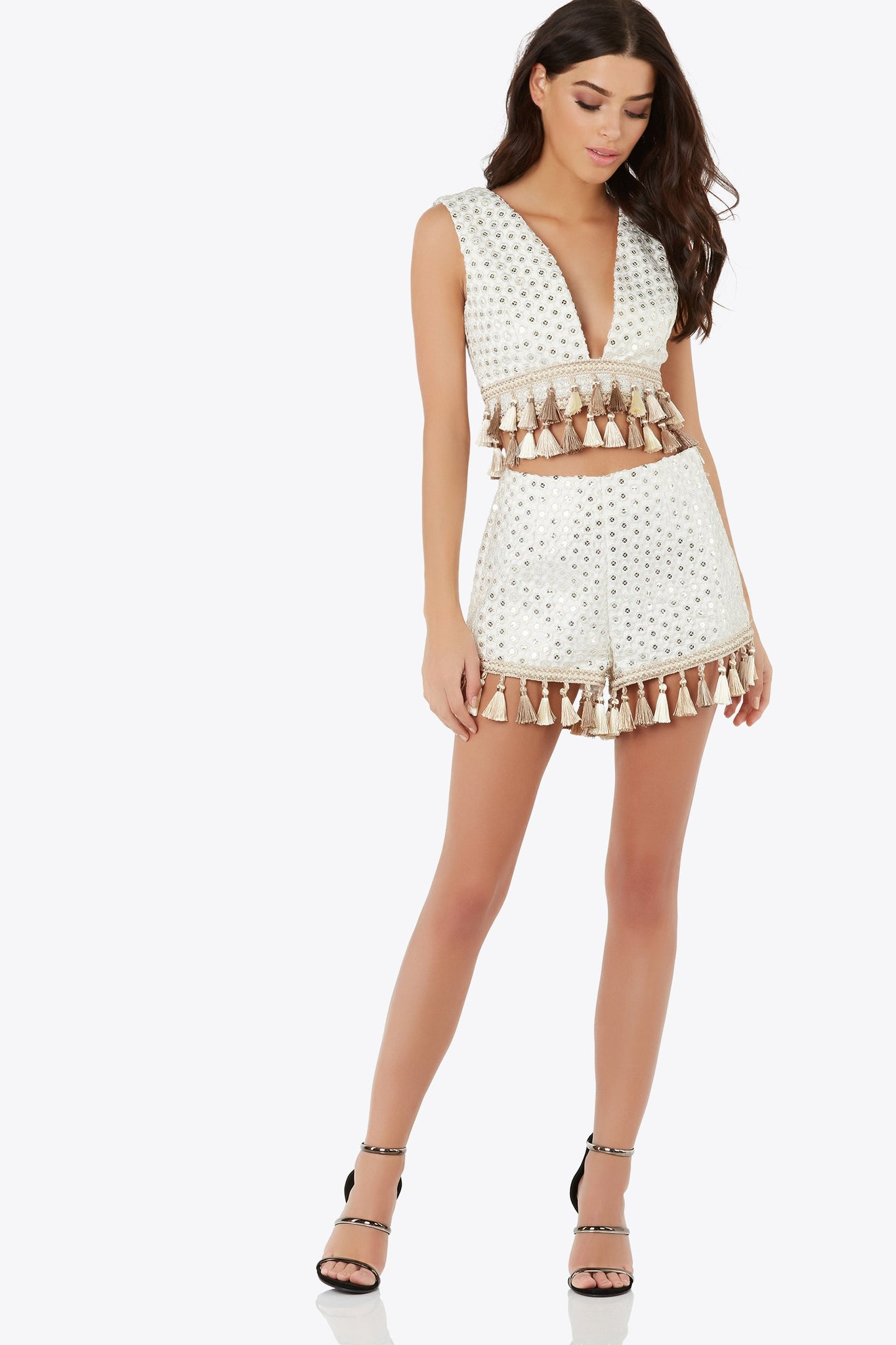 Slay the day in this embellished short with tassel accents. Fully lined with hidden side zipper.