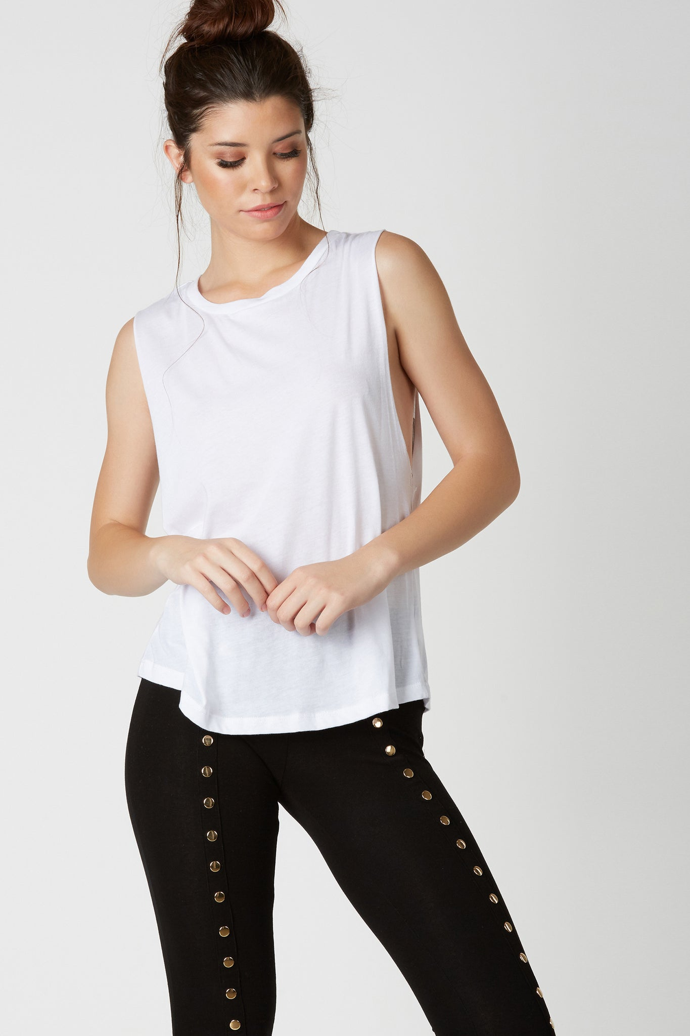 Soft basic muscle tank with relaxed fit and bold graphic in back. Rounded neckline and slightly curved hem finish.