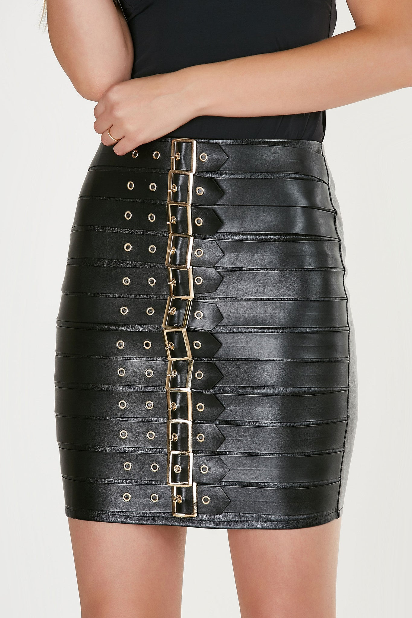 Sexy high rise mini skirt with faux leather finish. Bold belted design with gold hardware finish and back zip closure.