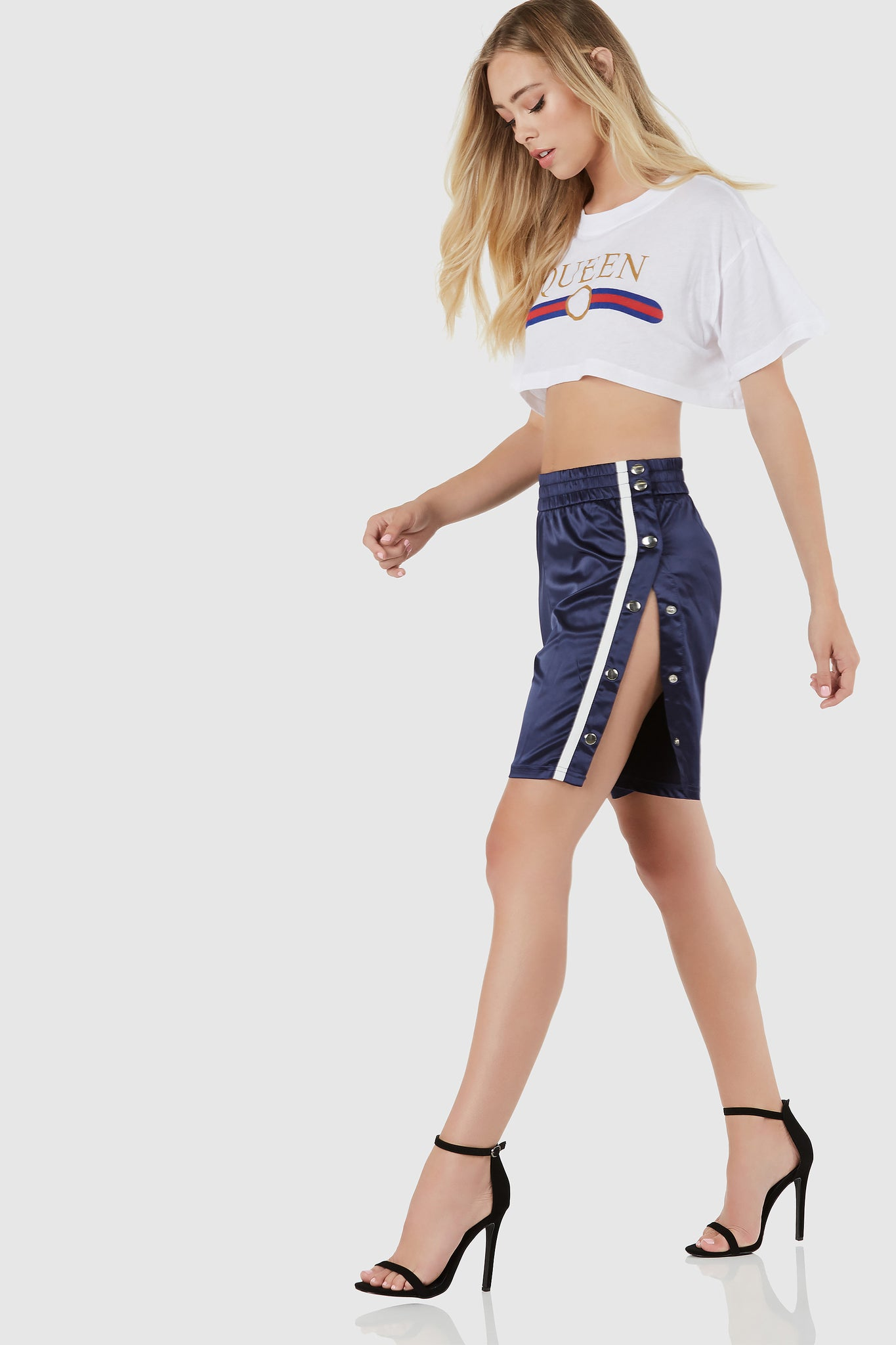 Trendy basketball shorts with contrast stripe pattern down each side. Snap button detailing with comfortable elasticied waist.