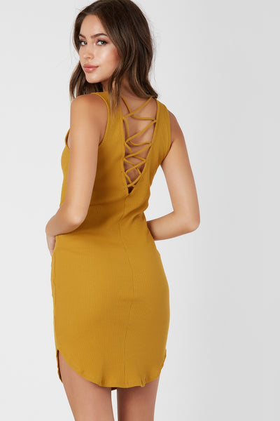 Casual sleeveless dress with U-neckline and rounded hem finish. Ribbed throughout with strappy detailing in back.