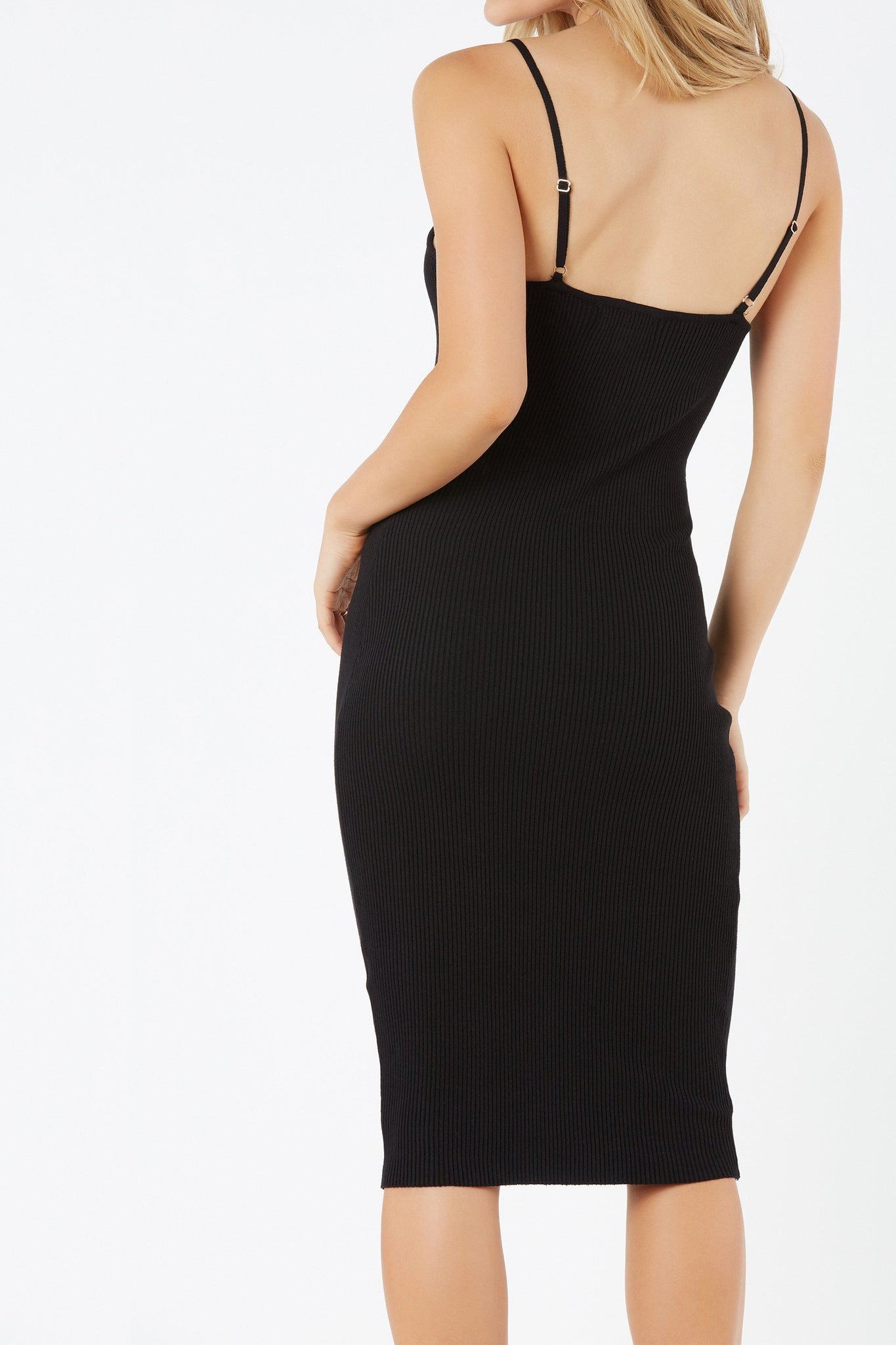 Sleeveless cami midi dress with bodycon fit. Ribbed throughout with trendy front zip and ring detail.