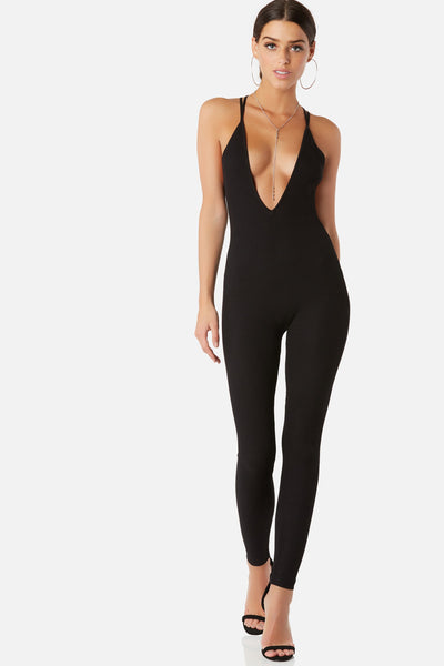 Sexy sleeveless jumpsuit with deep V-neckline. Ribbed throughout with stretchy fit and criss-cross strap finish in back.