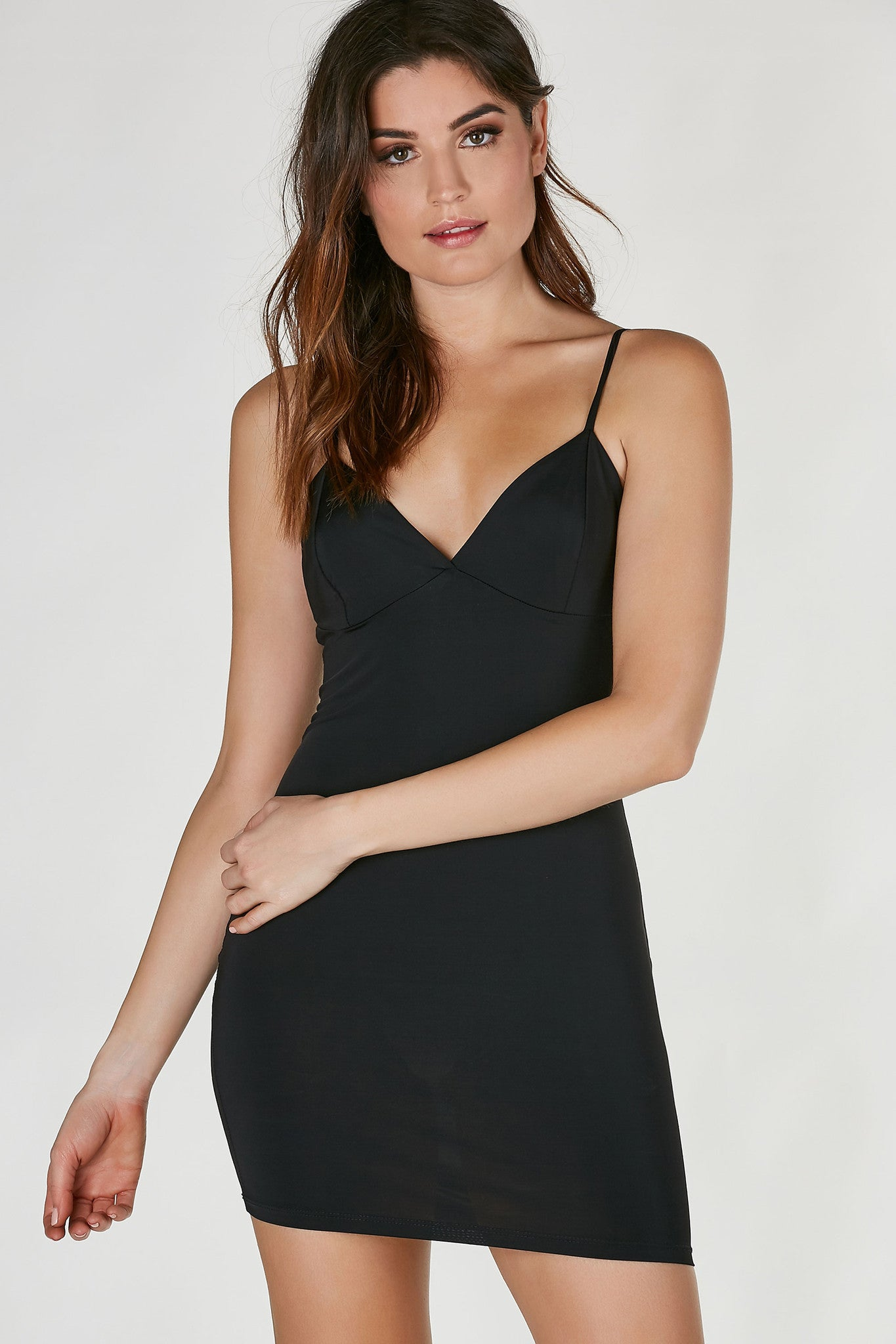 Slinky sleeveless mini dress with soft V-neckline. Comfortable flattering fit with straight hem all around.