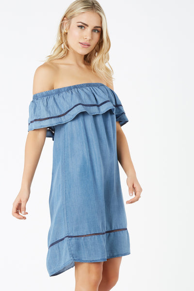 Chambray off shoulder dress with ruffle tier design. Peek-a-boo crochet trim detailing with relaxed fit.