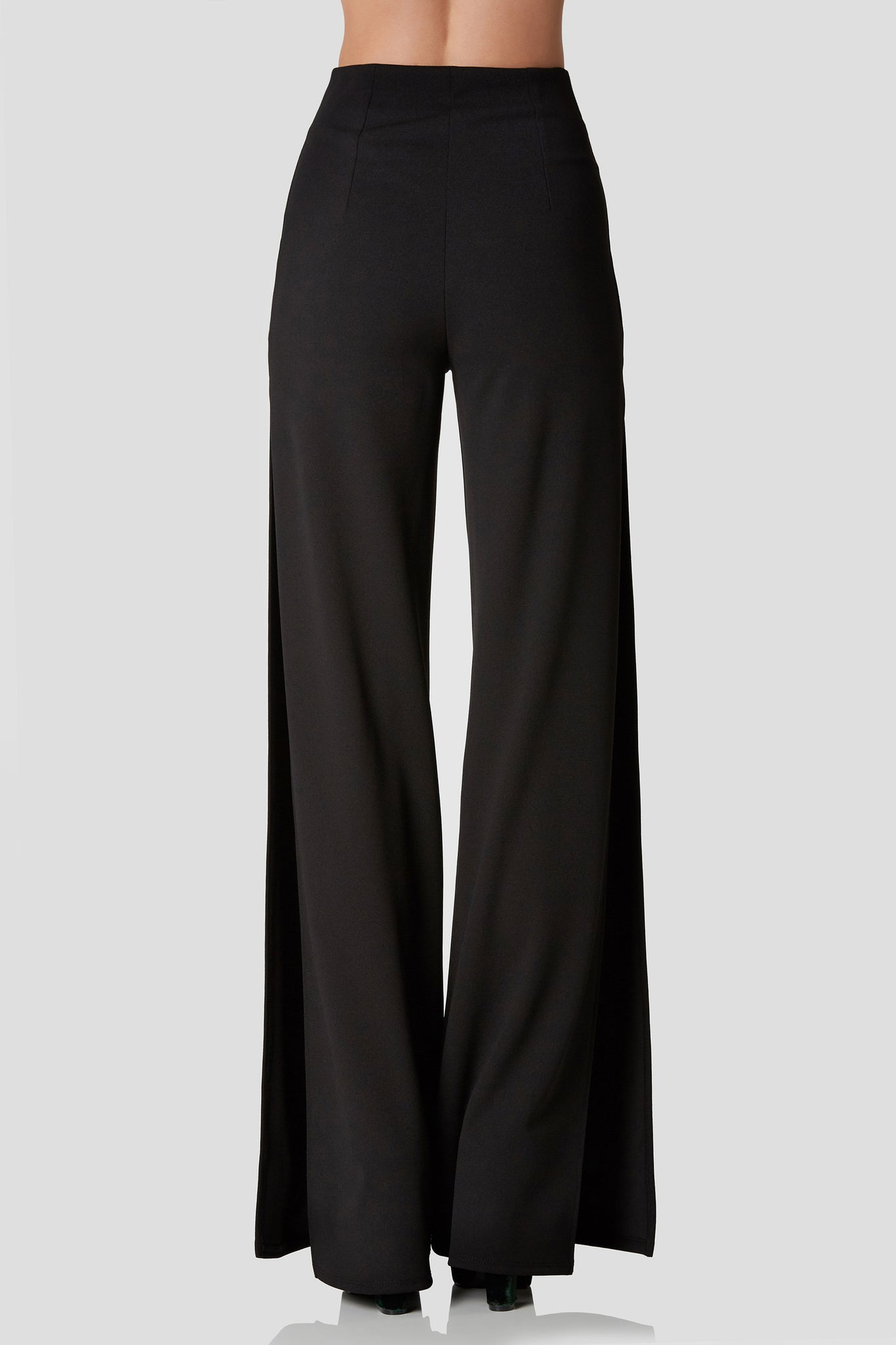 Chic high rise pants with trendy front center zip with hoop detailing. Flared hem with bold side slits.