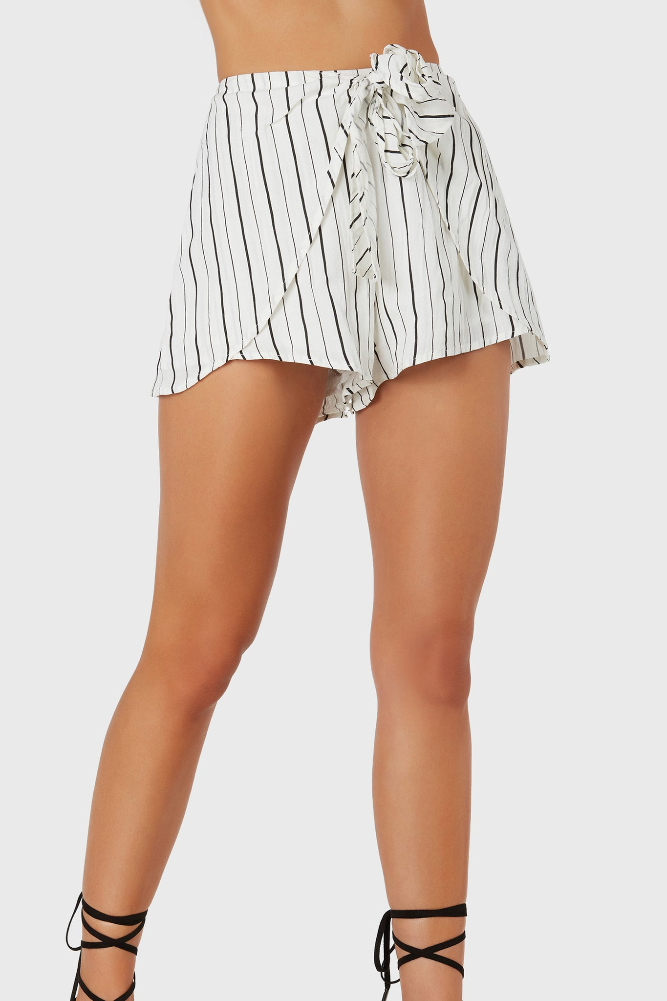 Flirty high rise shorts with stripe patterns throughout. Wrap style design with front tie detailing and back zip closure.