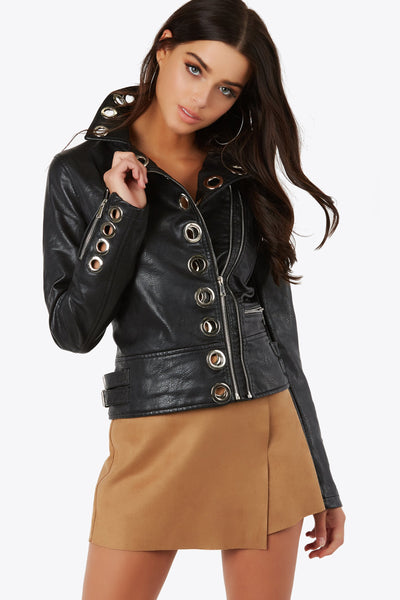 Dope vegan leather jacket with trendy eyelet detailing throughout. Silver hardware with asymmetrical front zip closure.