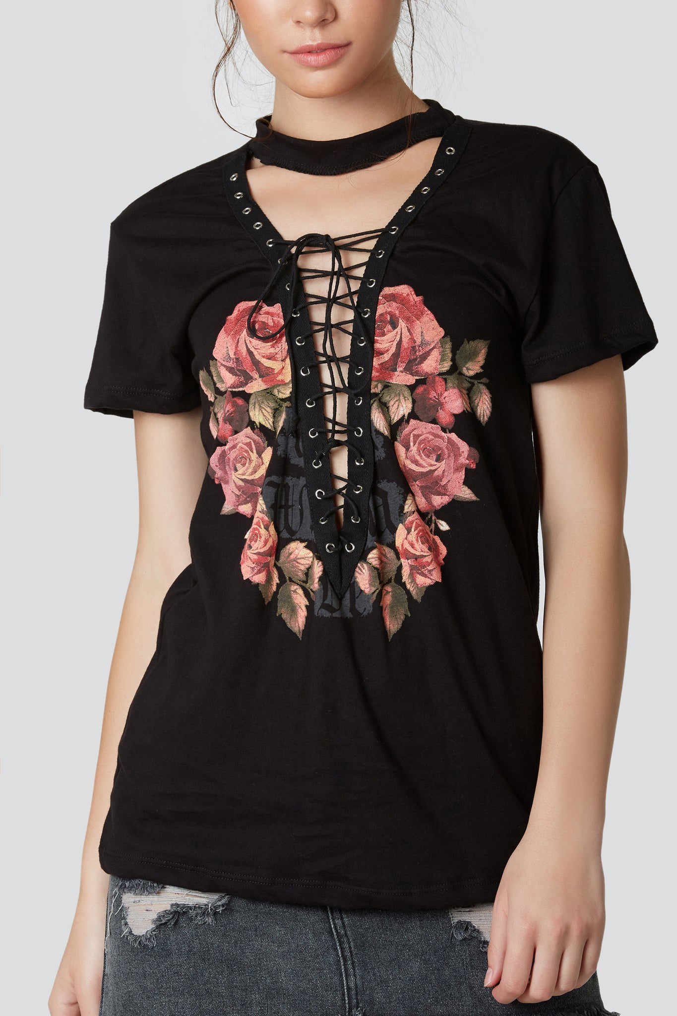 Trendy graphic T-shirt with plunging V-neckline with lace up design. Bold rose print in front with choker neckline.