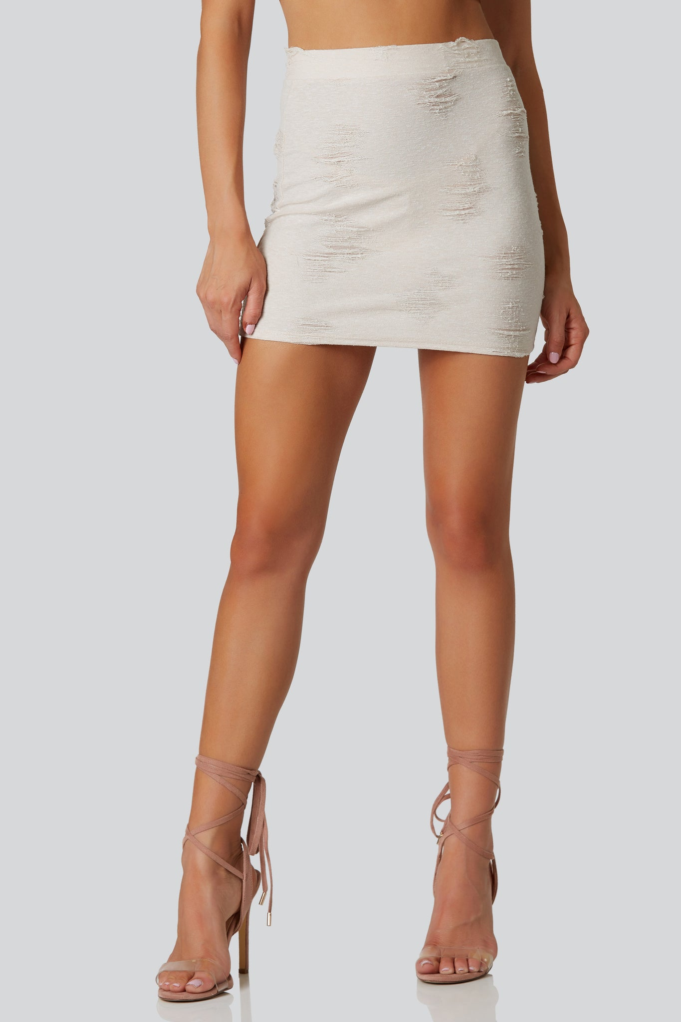 Casual bodycon mini skirt with distressing throughout. Stretchy material with straight hem finish.