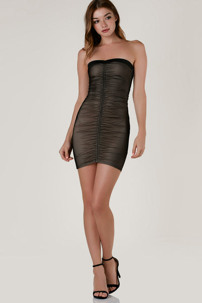 Sexy strapless mini dress with nude lining and sheer mesh exterior. Ruched down the center in front and back with bodycon fit.