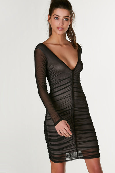 Sexy wide V-neck mini dress with full lining and smooth mesh exterior. Ruching throughout with stretchy bodycon fit.