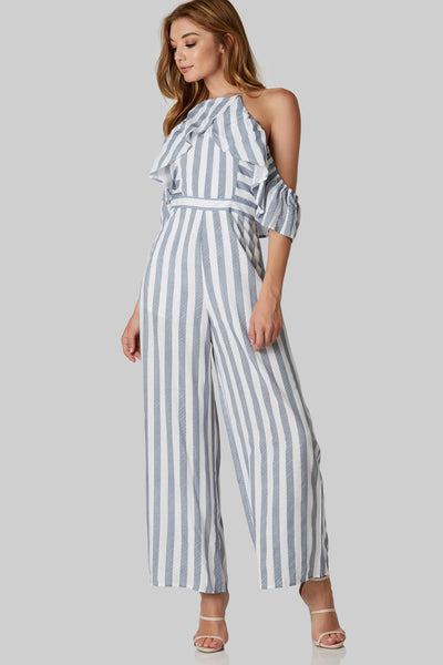 Flirty printed jumpsuit with high neckline and cold shoulder design. Stripe patterns throughout with ruffle detailing and back zip closure.