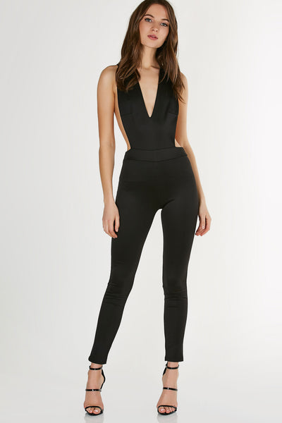Simple sleeveless jumpsuit with stretchy fit. Plunging V-neckline and sexy open back with criss-cross strap design.