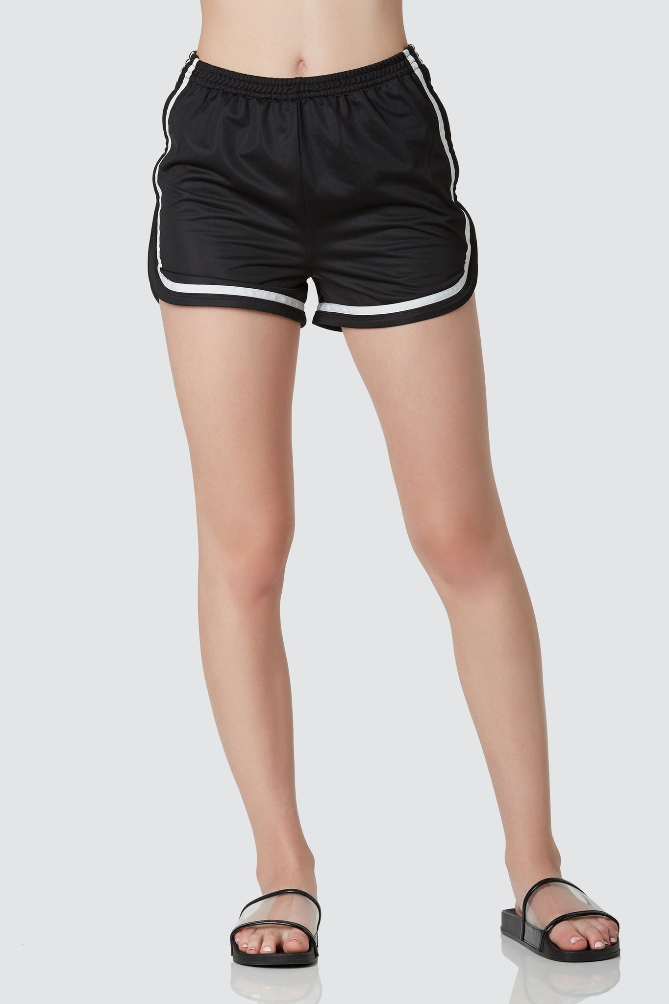 Trendy varsity shorts with contrast stripe print for an athletic vibe. Comfortable elastcized waist with curved hem finish.