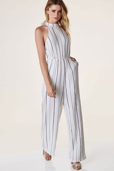 Chic halter style jumpsuit with nautical stripe patterns throughout. Open back with side pockets and relaxed fit.