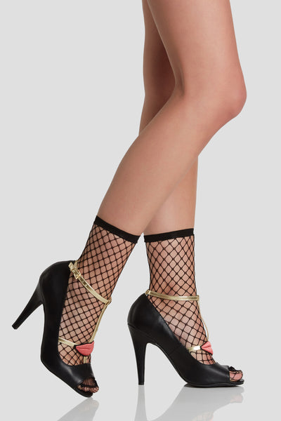 Sassy pair of heels with soft faux leather finish and peep toe design. Strappy detailing with adjustable buckle at ankle and contrast embroidered patch at center.