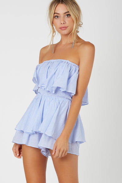 Flirty strapless romper with stripe patterns throughout. Tiered design with flared hem finish.