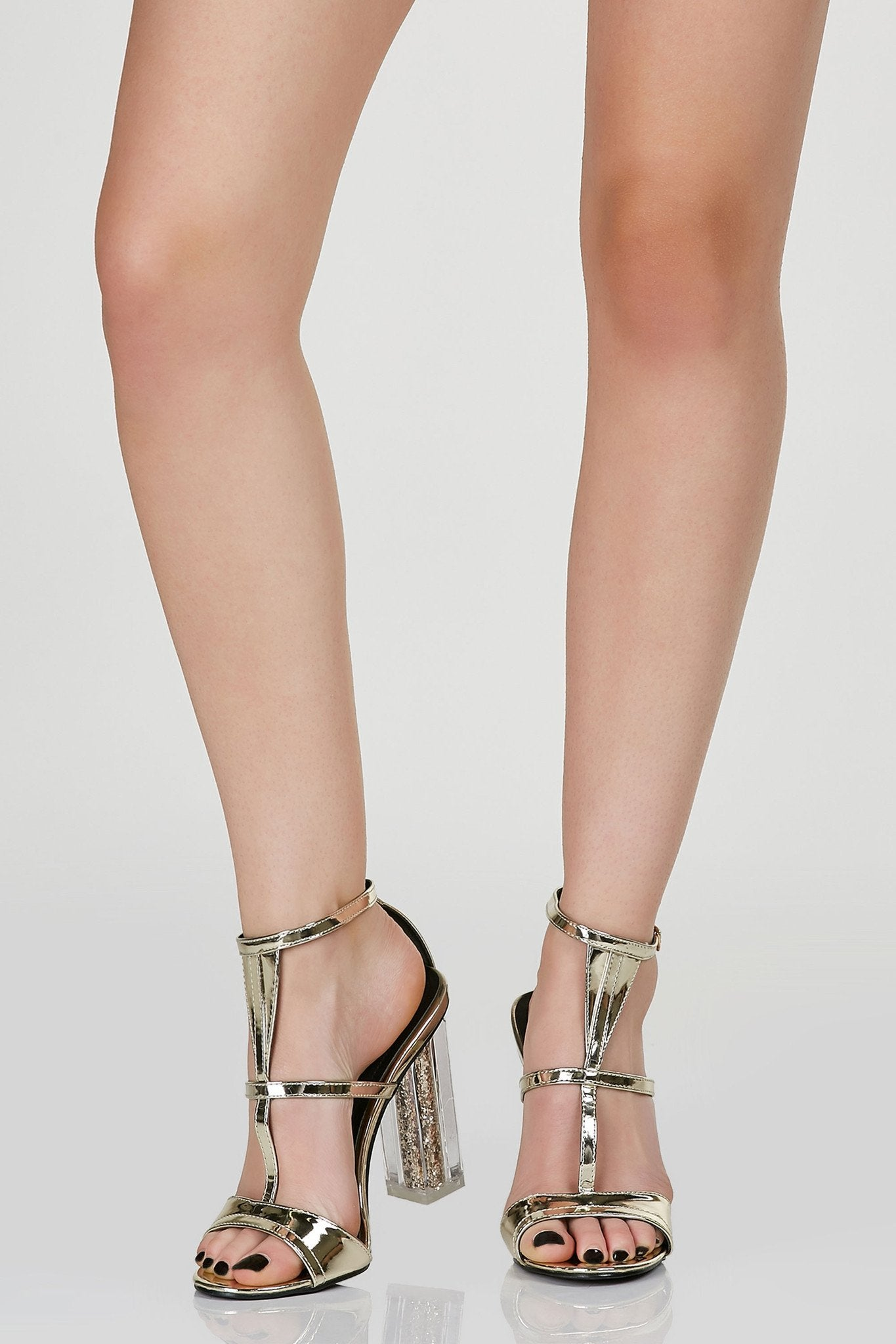 Chic strappy pumps with metallic finish. Ankle strap for fit and closure and clear block heels with sequin detailing.