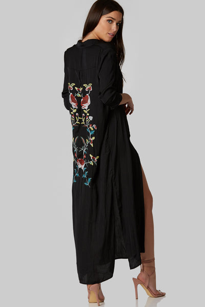 Stunning maxi dress made of comfy material. Intricate floral embroidery on back with long sleeves and button front closure.