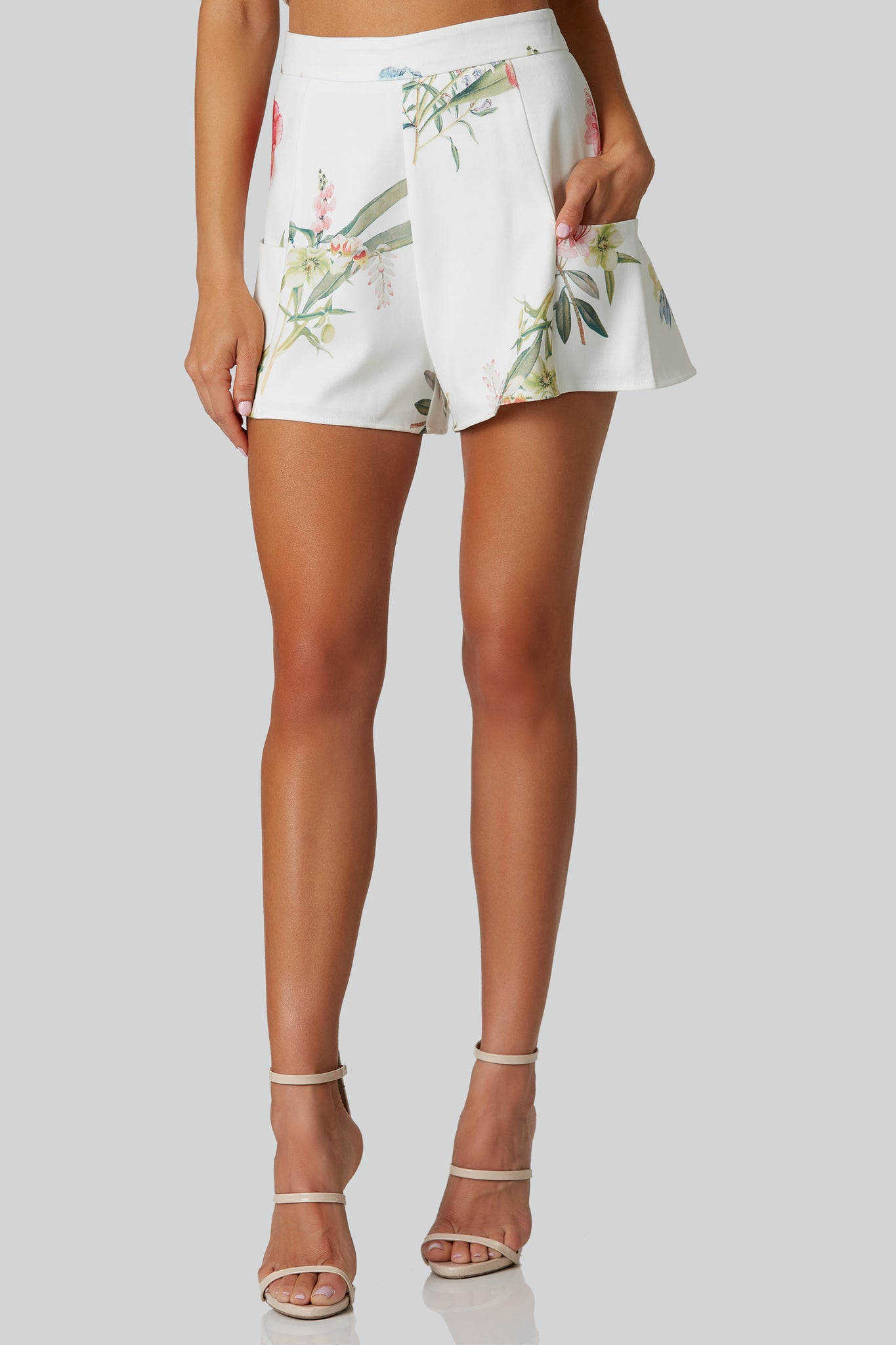 High rise printed shorts with floral patterns throughout. Fully lined with side pockets and back zip closure.