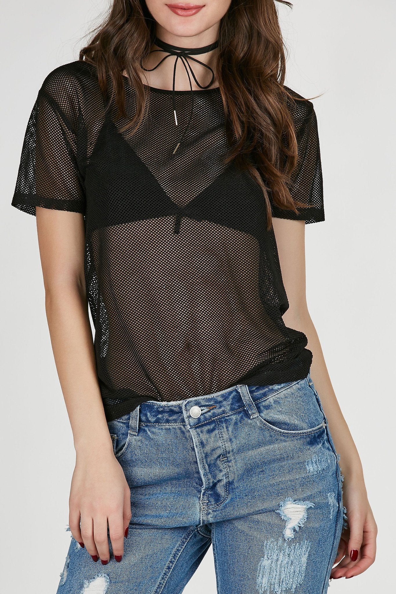Round neck fishnet top with relaxed fit. Short sleeves and straight hem all around.