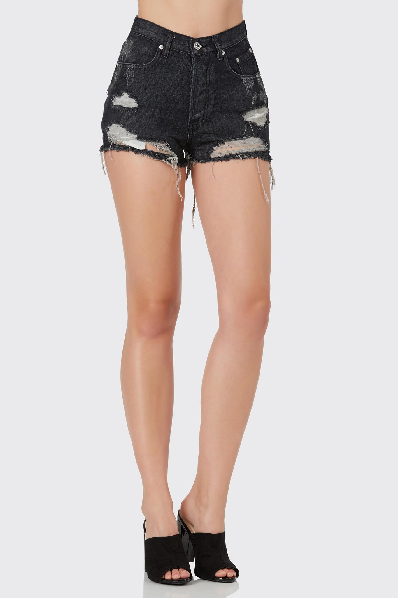 Basic high rise denim shorts with heavy distressing and raw hem finish. 5 pocket design with button up closure.