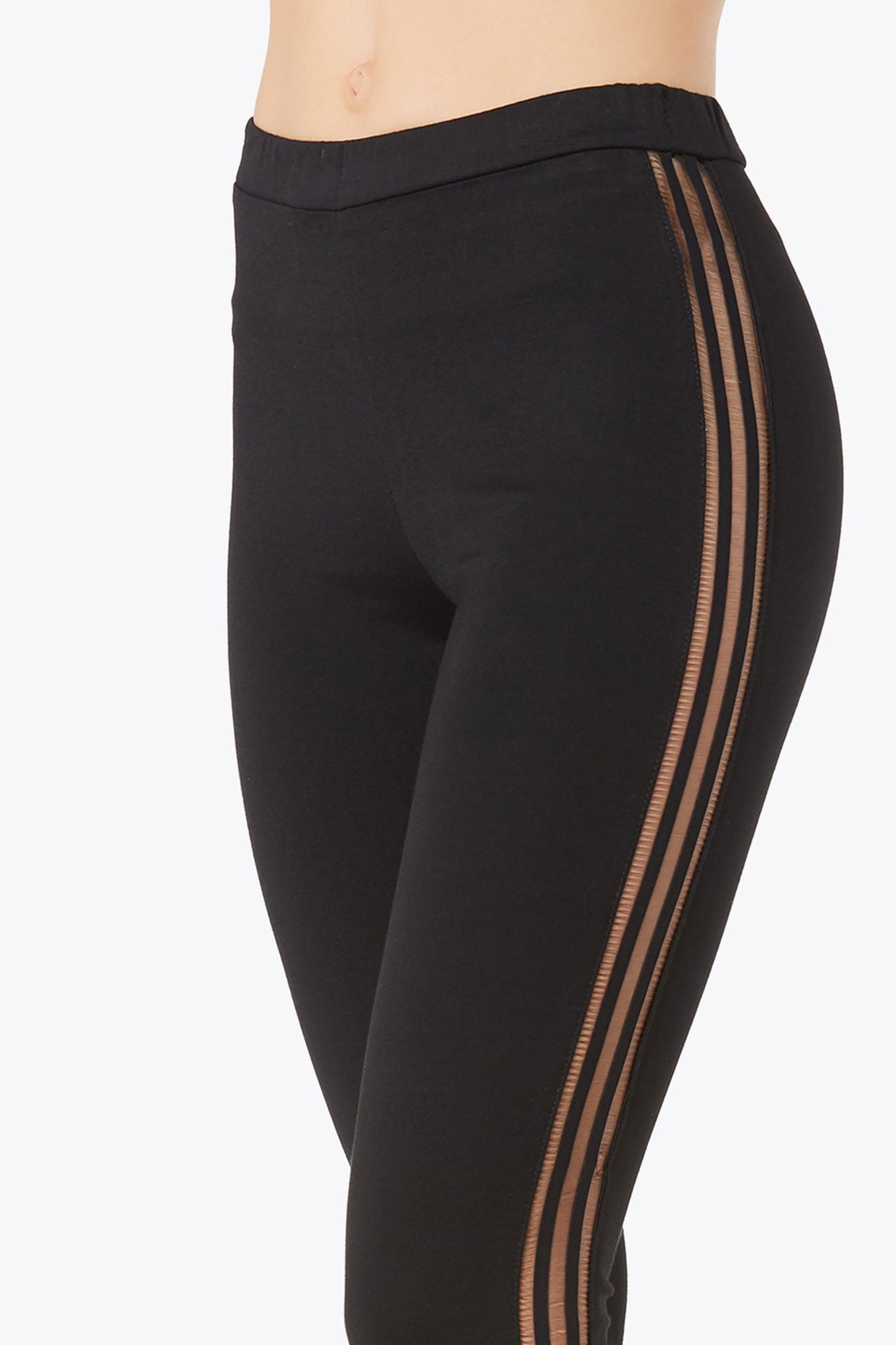 High rise pants with flattering slim fit. Trendy contrast mesh-like panel down each side and zipper detailing at hem.