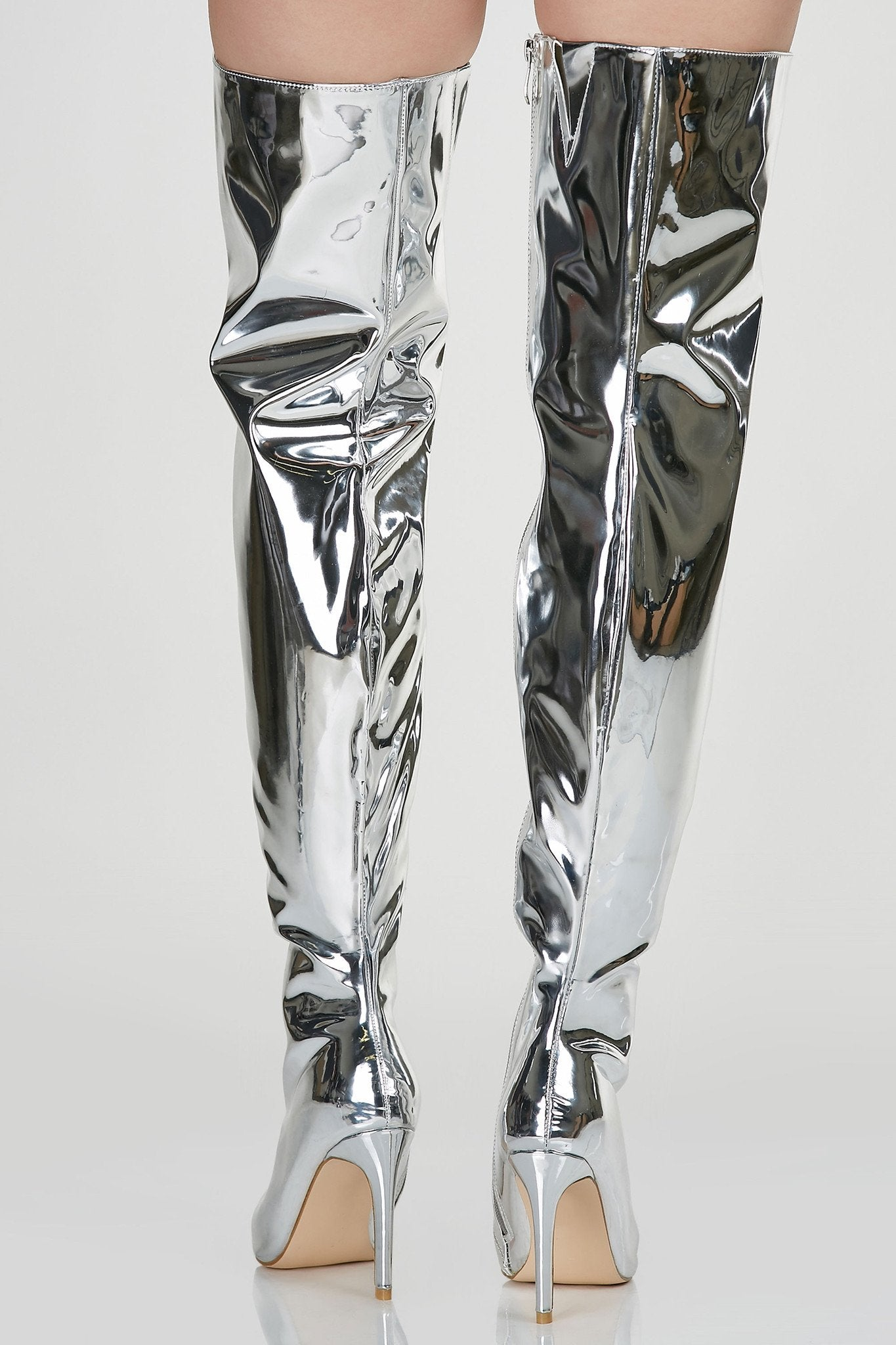 Sexy thigh high stilettos with shiny metallic finish. Side zip closure with pointed toe finish.