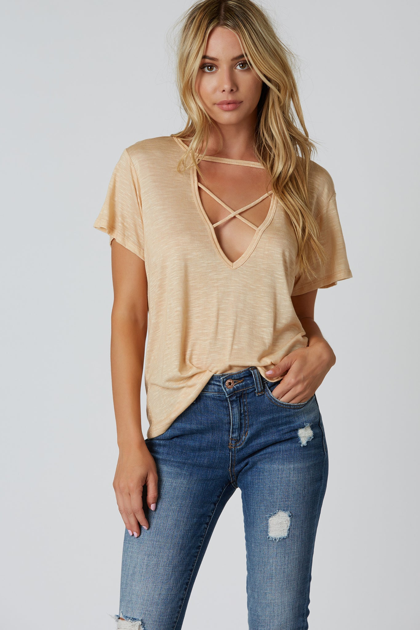 Comfortable oversized tee with deep V-shape cut out and strappy detailing. Soft lightweight material with straight hem finish.