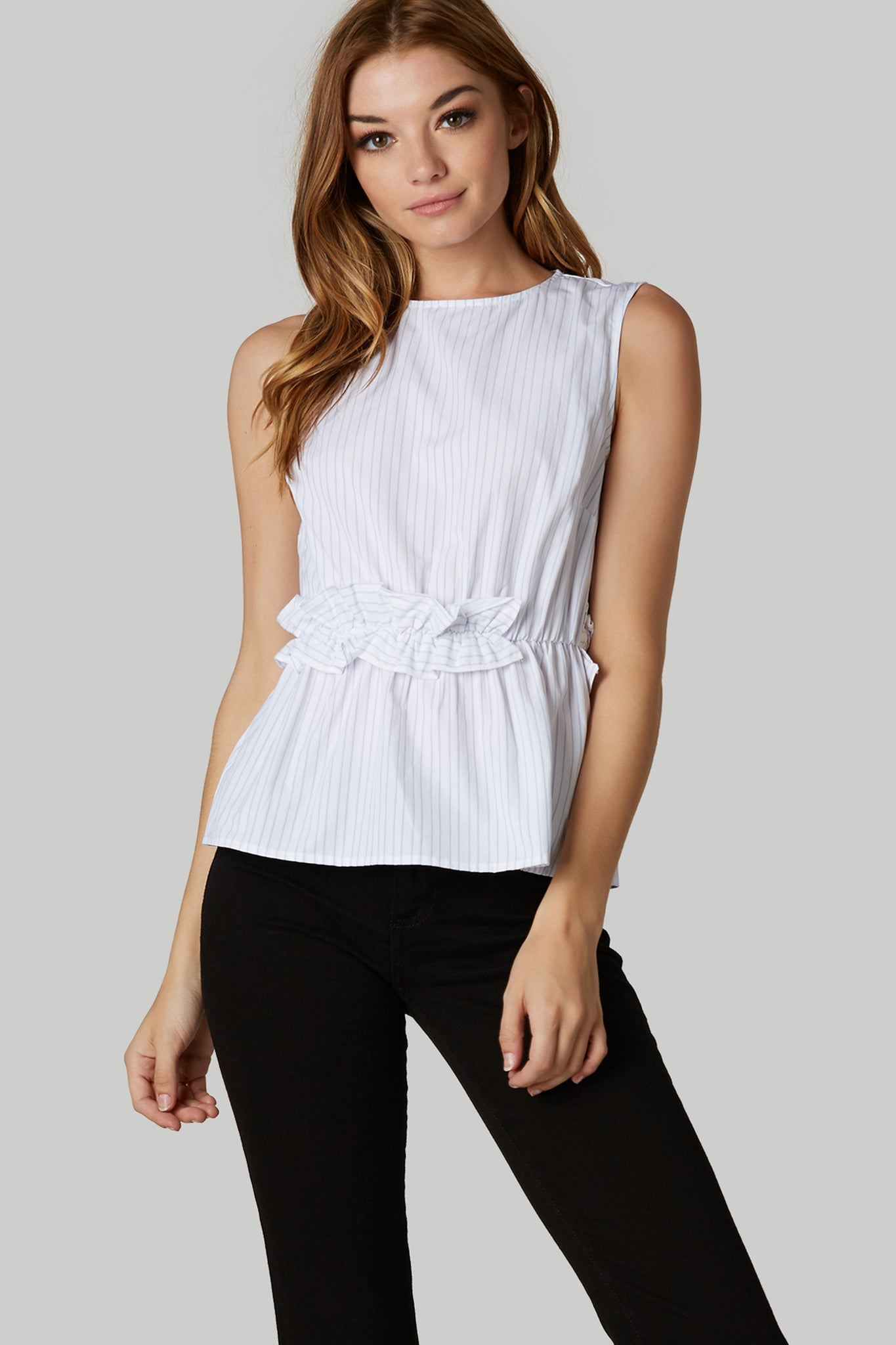Chic sleeveless top with crew neckline and ruffle detailing. Stripe patterns throughout with button closure in back.