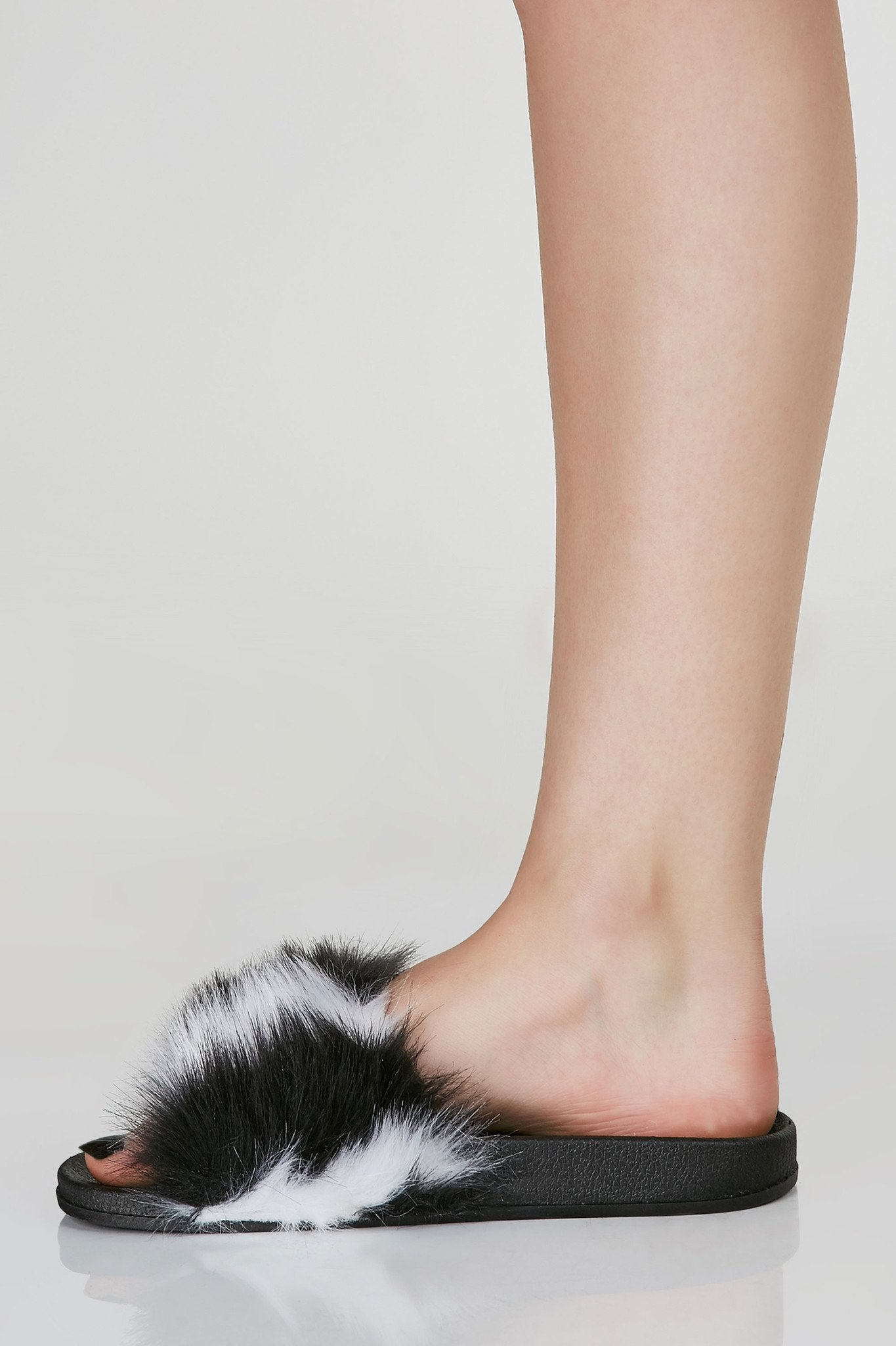 Comfortable faux fur slides with open toe finish.