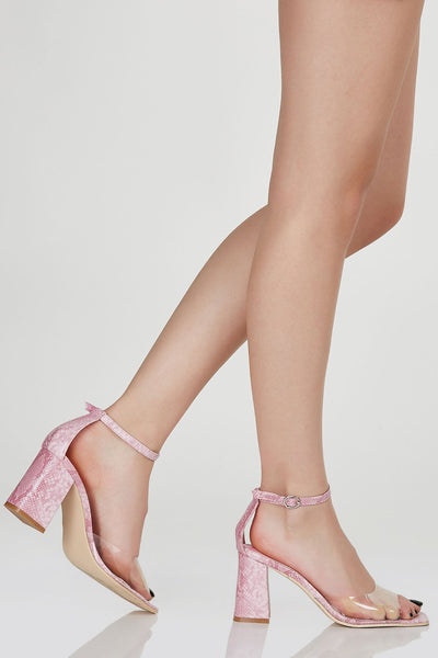 Chic block heel sandals with ankle strap for fit and closure. Contrast bold clear strap with square toe finish.