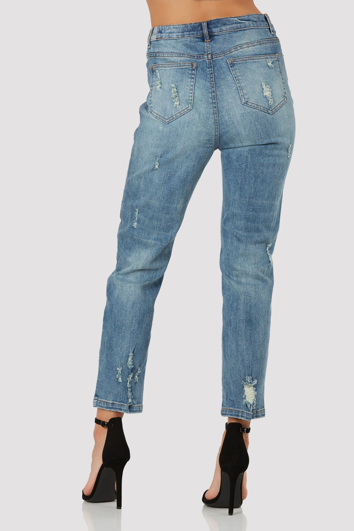 Stylish high rise jeans with bold floral patches in front. 5 pocket design with distressing throughout.