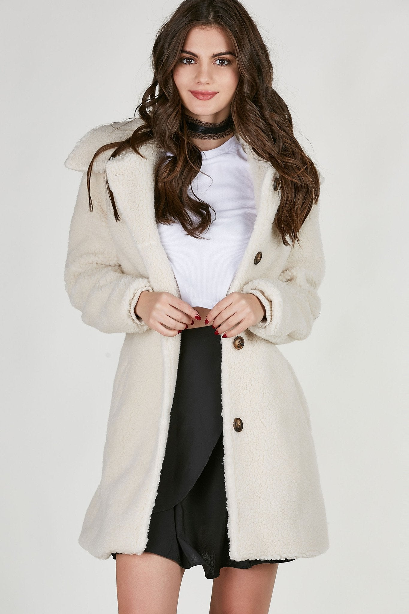 Chunky faux shearling coat with cozy collar and buttons down the front for closure. Relaxed fit with full lining and functional pockets.