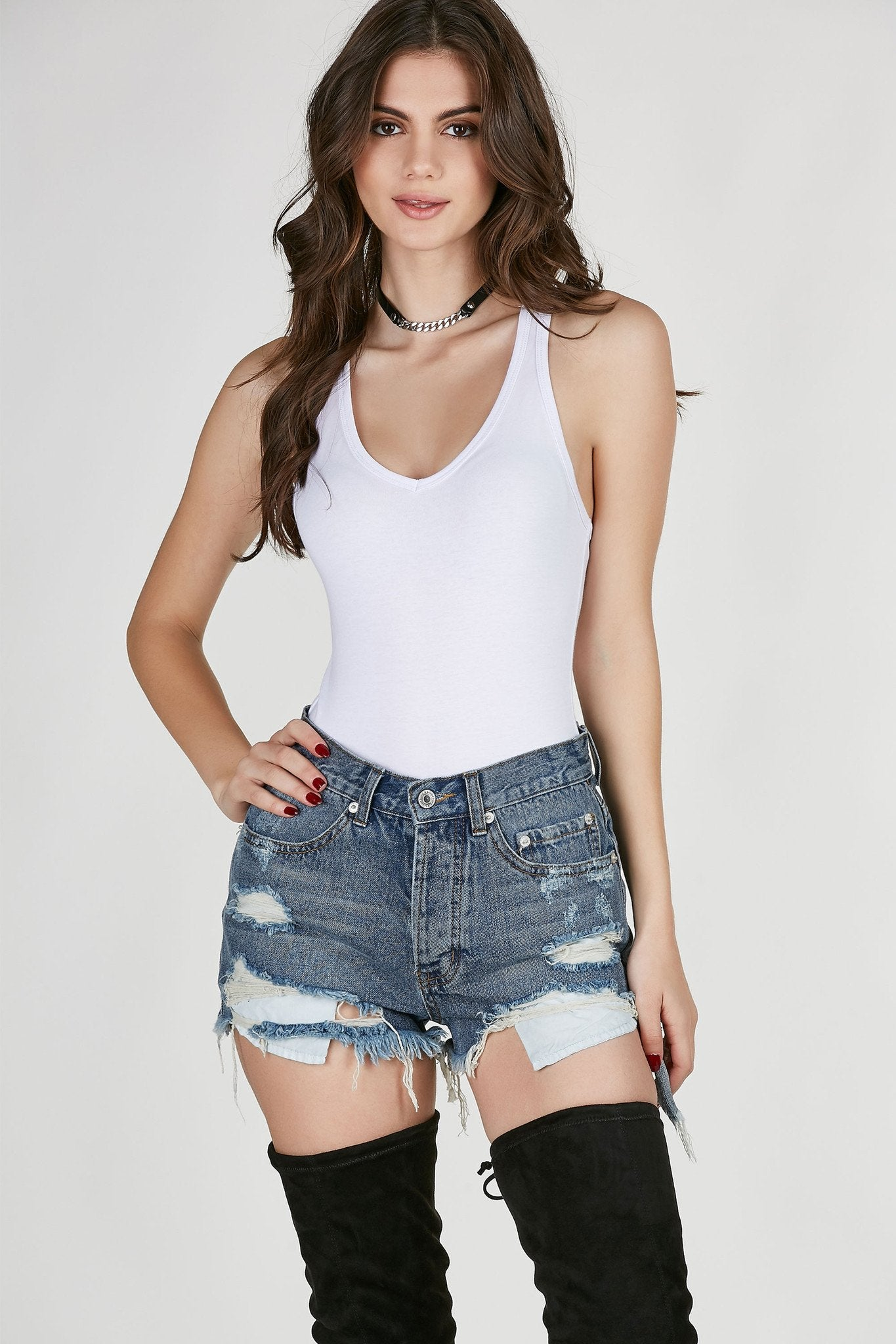 V-neck sleeveless bodysuit with racerback finish. Stretchy material with snap button closure at bottom.