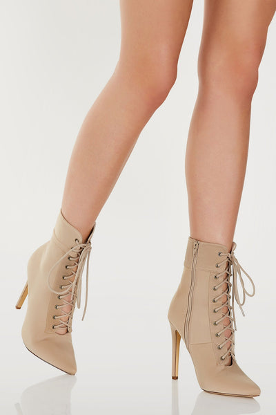 Sexy above the ankle boots with pointed toe and stiletto heels. Lace up design with inner side zip closure.