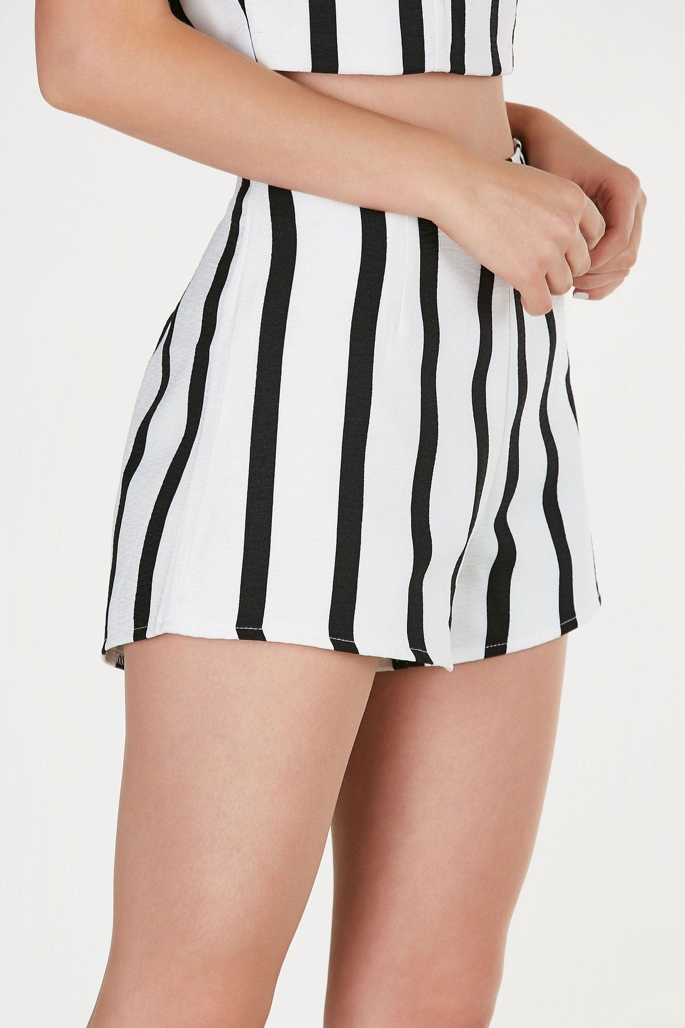 High rise shorts with bold stripe patterns throughout. Fully lined with back zip closure. Comes in a set with matching top sold separately.