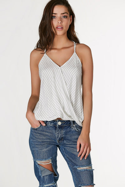 Chic printed tank top with overlap design in front. Stripe patterns throughout with strappy caged design in back.