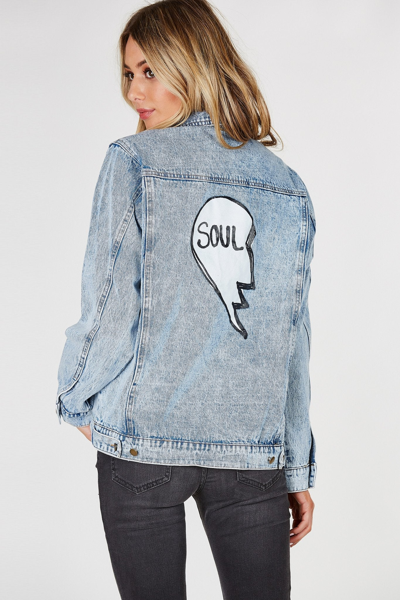 Oversized denim jacket with light acid wash. Patched in front with graphic in the back to match with your Soul Mate!
