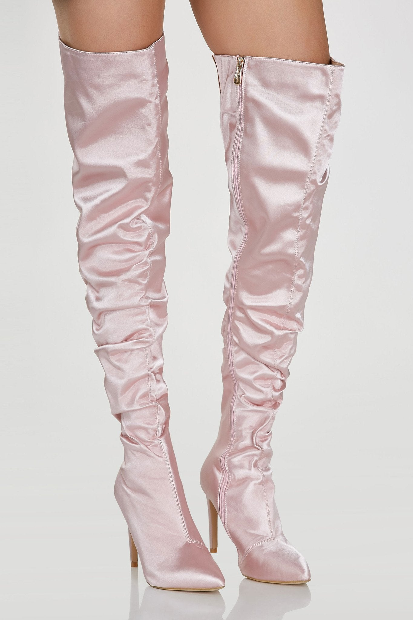 Smooth satin thigh high boots with stiletto heels. Slight ruched effect with side zip closure and pointed toe finish.