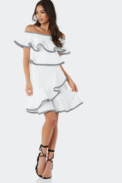 Chic off shoulder dress with ruffle tier design. Contrast stripe detailing with back zip closure.