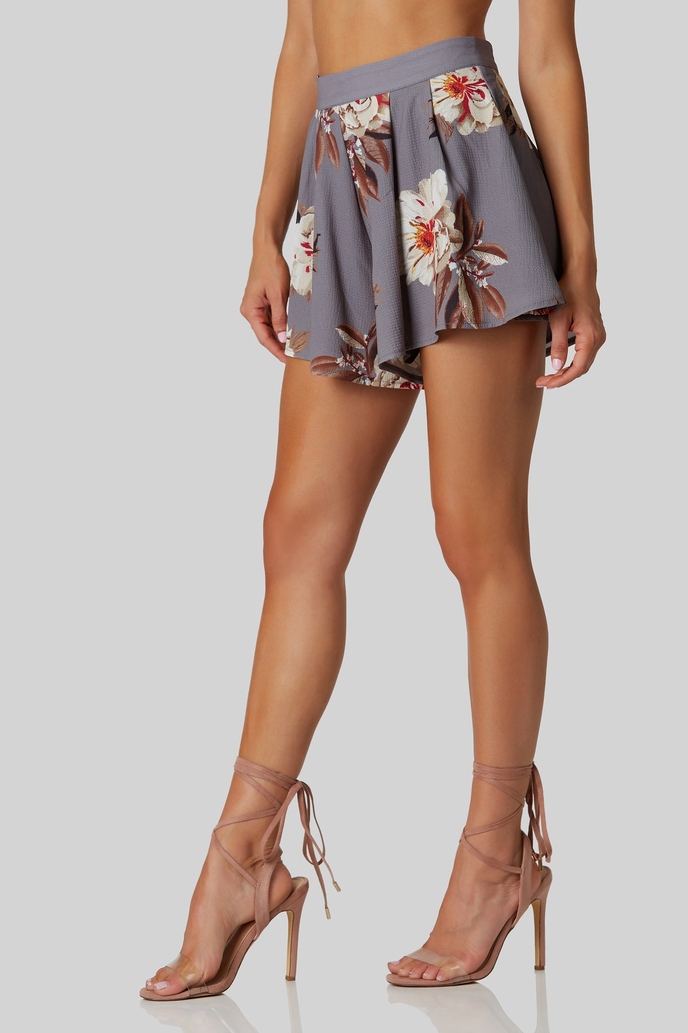 Flirty high rise shorts with floral print throughout. A-line hem with full lining and back zip closure.