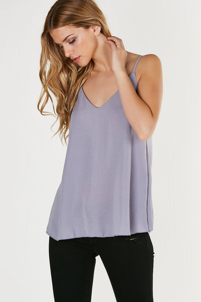 Classic V-neck cami with dainty spaghetti straps and straight hem all around. Lightweight material with oversized fit.